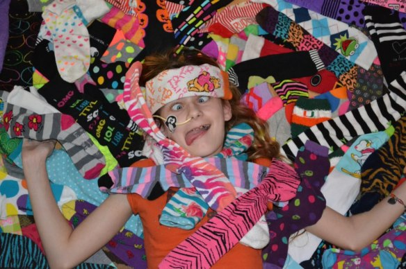 Melanie Dickens, Crazy Sock Girl, to post on blog with permission from her Dad Shawn, x